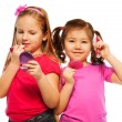 Two little girls make up — Stock Photo