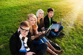 Four students with laptop — Stock Photo