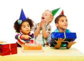 Three kids with birthday cake and peresents — Stock Photo