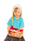 Little blond girl with Easter eggs — Stok fotoğraf