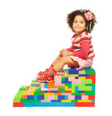 Dark skinned girl and toy blocks — Stock Photo