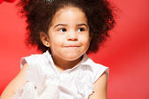 Portrait of little cunning curly haired girl — Stock Photo
