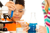 Boy and chemistry — Stock Photo