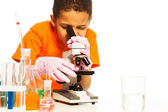 Cute black boy looking into microscope — Stock Photo