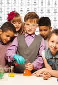 Group of kids on chemistry lesson — Stock Photo