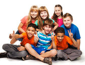 Group of happy diverse looking boys and girs — Stock Photo