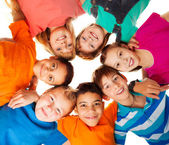 Circle of happy kids together smiling — Stock Photo