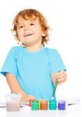Happy shy kid painting — Stock Photo