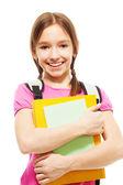 Feliz sorridente colegial com livros — Fotografia Stock
