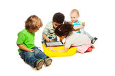 Four kids playing tablet computer — Stock Photo