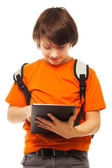 Boy occupied with tablet computer — Stock Photo