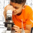 Black boy looking in microscope — Stock Photo #24686783