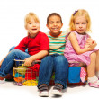 Three kids sitting in the clothes basket — Stock Photo
