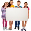 Stock Photo: Four kids showing board with advertising