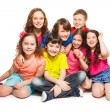 Group of happy kids sitting together — Stock Photo #24688217