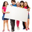 Five kids showing blank board — Stock Photo