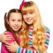 Two happy girls hugging — Stock Photo #24688973