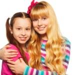 Two happy girls hugging — Stock Photo