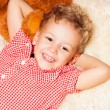 Happy blond kid  on the furs — Stock Photo