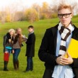 Smart student in park - Stock Photo