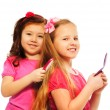Two girls brushing hair — Stock Photo