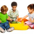 Two boys and girl playing with tablet — Stock Photo