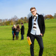 Confident student in park - Stock Photo