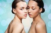 Beauty portrait of 2 beautiful women — Stock Photo