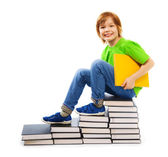 Clever boy on pile of books — Stock Photo