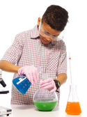 Clever boy exerimenting in the lab — Stock Photo