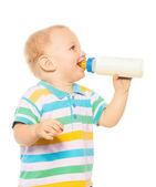 Happy blond toddler with formula — Foto Stock