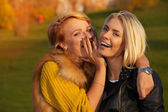 Laughing girls in sunny park — Stock Photo