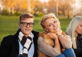 Happy company in autumn park — Foto de Stock