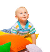 Happy toddler in pillows — Stock Photo