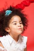 Kissing little black curly girl — Stock Photo