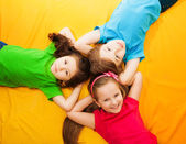 Kids laying on the floor — Stock Photo