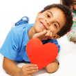 Cute five years old boy with heart symbol — Stock Photo #24690053