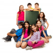 Large group of school kids and blackboard — Stock Photo