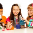 Three kids and chemistry lesson — Stock Photo