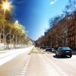 Barcelona boulevard, day and night — Stock Photo