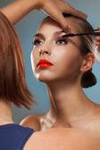 Makeup artist at work — Stock Photo