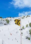Avalanche medium risk warning flag — Stock Photo