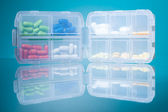 Dosage plastic drugs container — Stock Photo