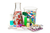 Many different drugs and tablets in laboratory glassware — Stock Photo