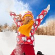 Stock Photo: Little girl throw snow