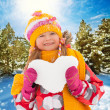 Bright girl with snow heart — Stock Photo