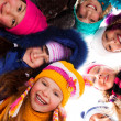 Circle of happy kids outside — Stock Photo