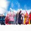 Group of happy kids throwing snow — Stock Photo #28474929