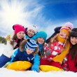 Stock Photo: Group of happy kids outside at winter