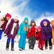 Group of happy kids outside on snow day — Stock Photo